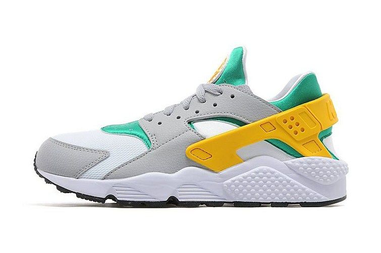 low priced 9ec34 c9a5c Nike Decorates the Air Huarache in Green, Gold   Grey