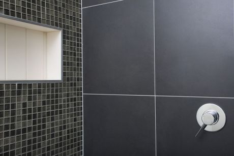 like the idea of large square tiles in shower. grey with