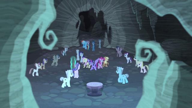 More zombie ponies surround the mane six .