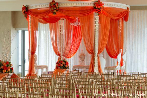 The Fabric Draped Mandap Of Orange At Indian Wedding Ceremony