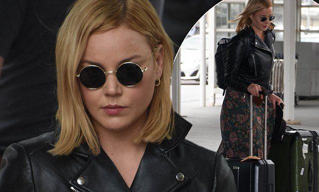 Abbie Cornish cuts a stylish rocker chic look as she arrives in Sydney