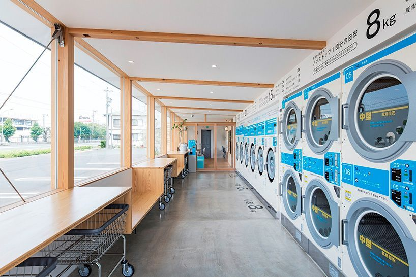 Modern Laundromat Cafe In Japan Helps Customers Pass The Time Laundry Shop Laundry Design Laundry Business
