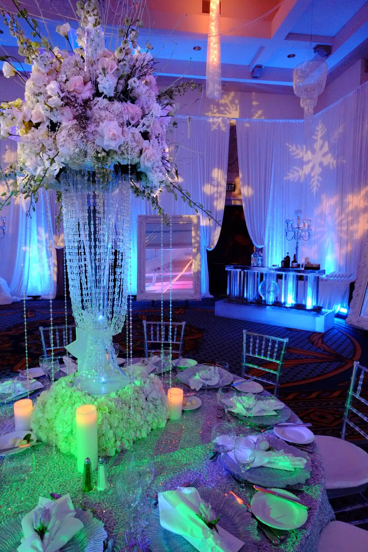 Wedding room decoration ideas 2018  Pink roses in a bed of blue uplights  Wedding in   Pinterest