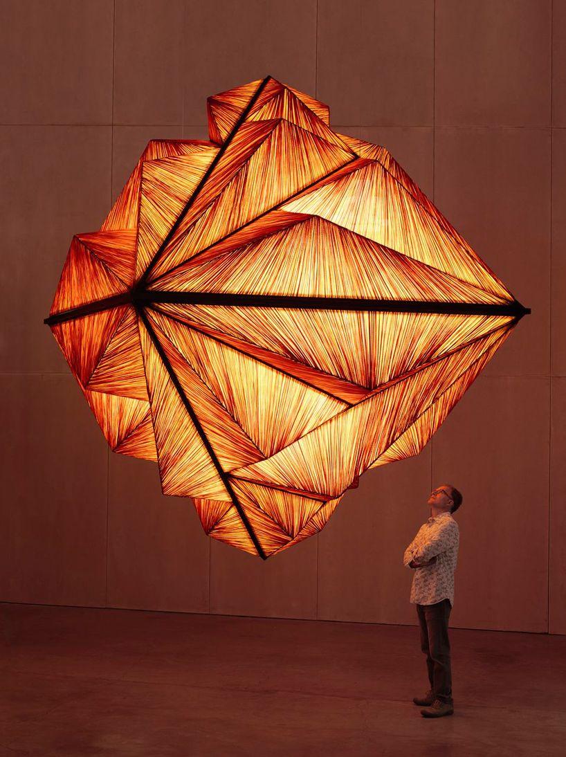 quite a big pendant light a pyramid lighting structure. Black Bedroom Furniture Sets. Home Design Ideas