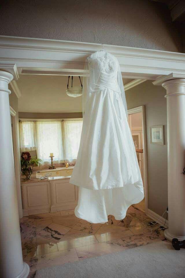 Elegant red and white wedding gown  #seattleweddingplanner #customdecor www.essenceofevents.com