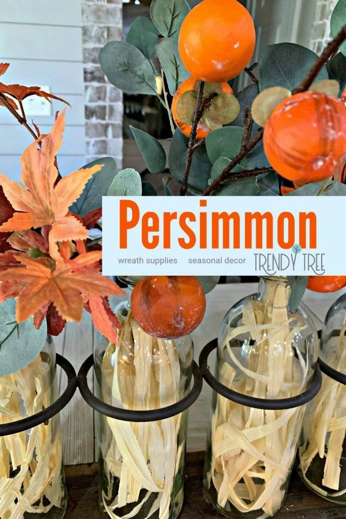 This bottle container is the perfect thing to use to create a unique and beautiful home decoration for any season. See how the persimmon color scheme works in this display. Get even more inspiration at Trendy Tree.