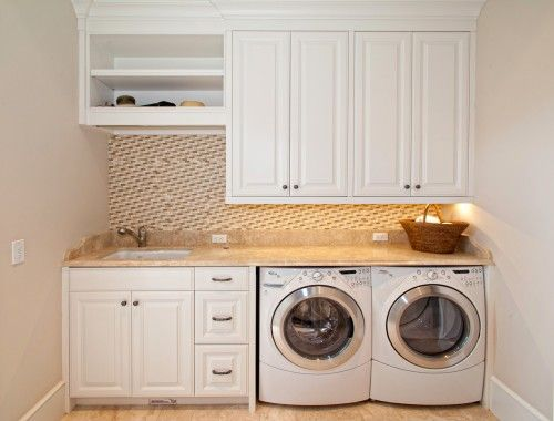 Perfect mudroom/laundry room. Front loading appliances so folding counter can go on top, sink, and storage. I'd make the open shelving a hanging bar for drying clothes, though.