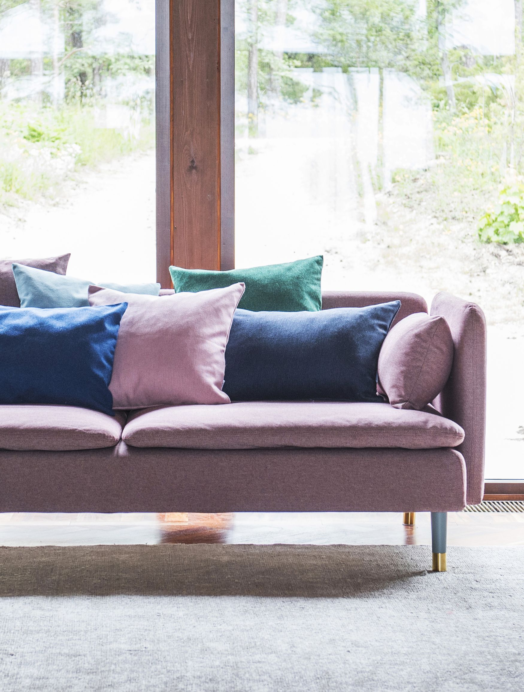 Think Pink Mid Century Modern House Huge Windows Pink Sofa With Multi Coloured Scatter Cushions Ikea Soderhamn Sofa With A Be Ikea Sofa Ikea Couch Sofa