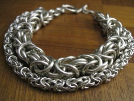 Byzantine chainmaille - had a bracelet like this from an ex in high school once, got pissed and threw it at him. It was really pretty, I wish I'd kept it. :c But now I'm going to try to make my own, so haHA.