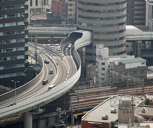 Highway passing through a skyscraper Japan #Tokyo_Hotel ~ http://VIPsAccess.com/luxury-hotels-tokyo.html