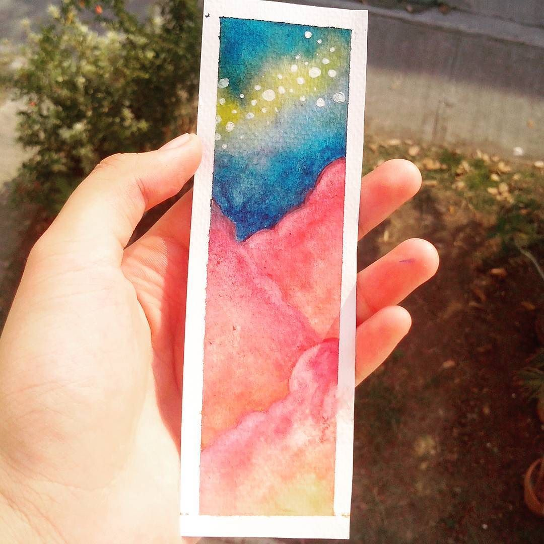 Bookmark // Forgive my hand // Materials used: Watercolor watercolor paper and white gel pen. // Q: Who would want it if I laminated it? Just asking.  #watercolor #bookmark #cansonwatercolorpaper #paint #painting #clouds #nightsky #pink #blue #color #colorful #doityourself #filtered by x_notsocreative_x