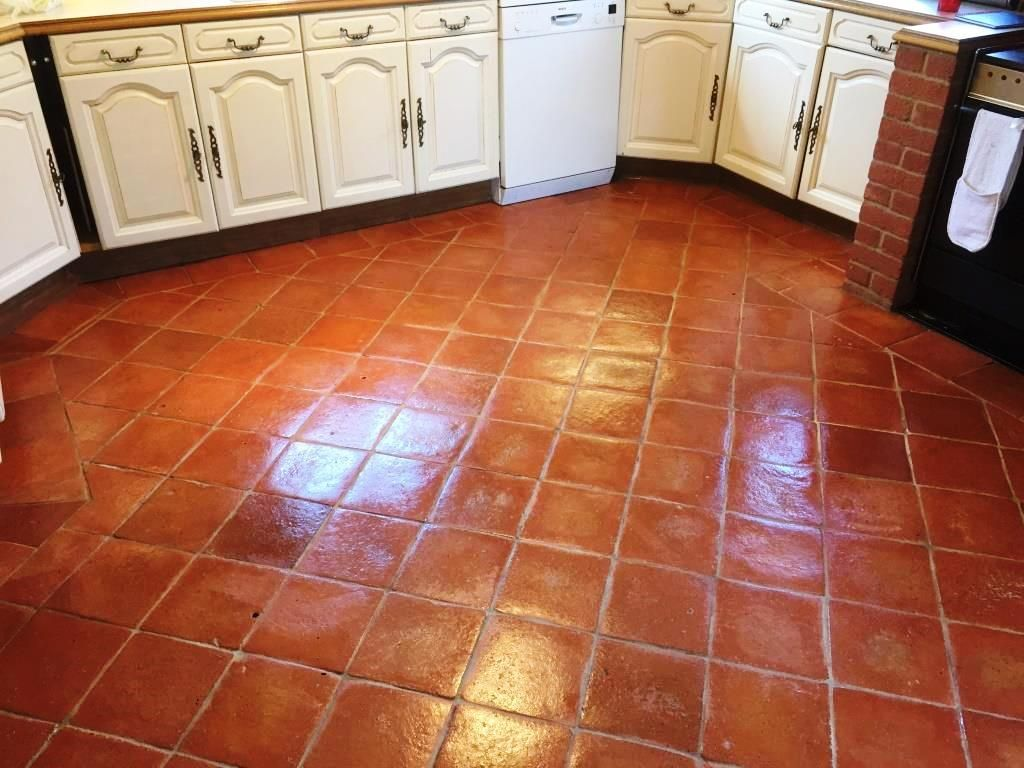 Terracotta floor tile  A type of floor popular for kitchens, baths,  entrances