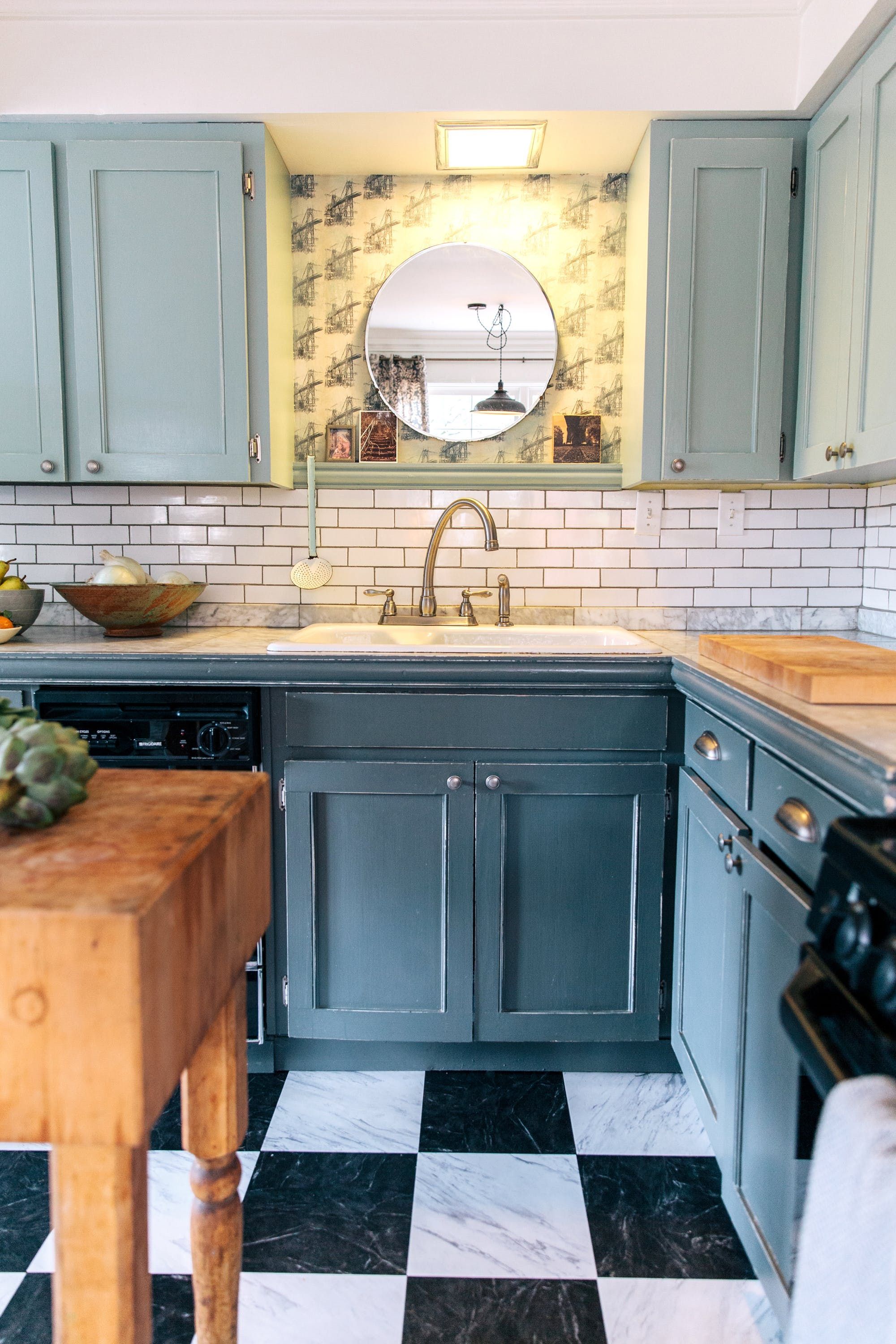 """""""Custom wallpaper made on Spoonflower fills in the space between the upper cabinets in the kitchen. Grounded with the dark grey below, the two-toned ..."""