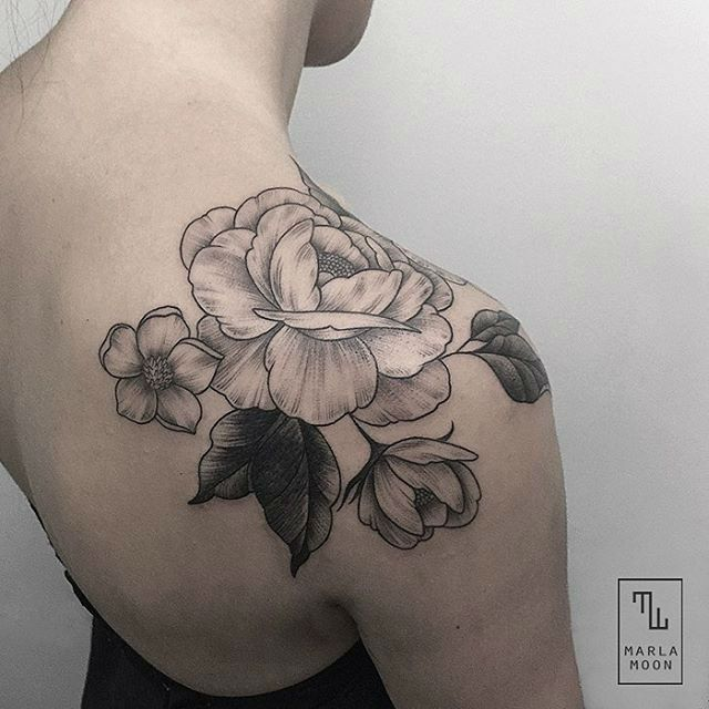 Huge flower tattoo on a shoulder, stunning!