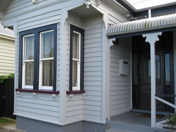 Resene Double Rakaia on house exterior - dark red window sills
