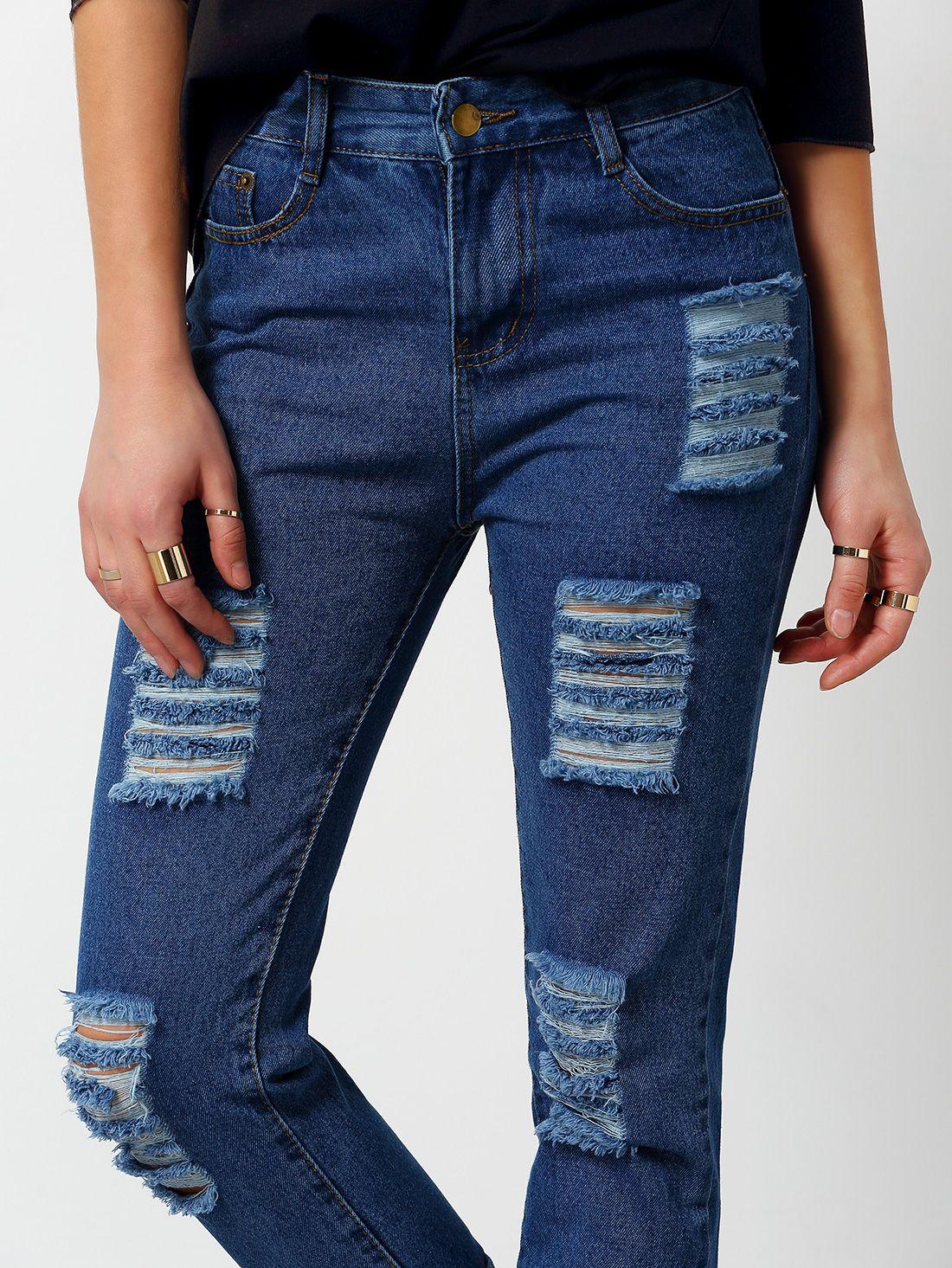 Photo of Pantaloni in denim strappati-blu