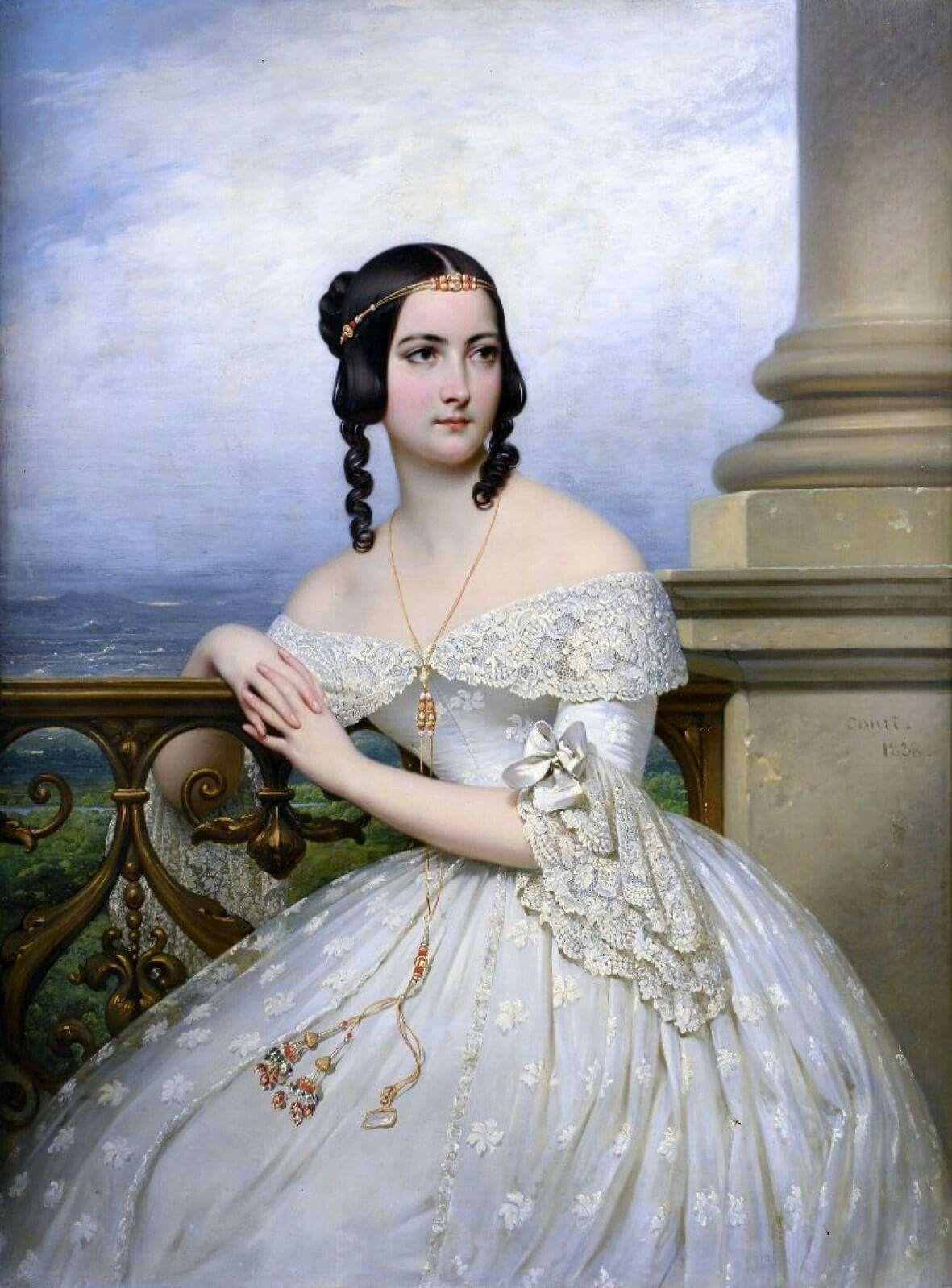 Joseph-Désiré Court (Rouen, 1796 - Paris, 1865) - Portrait présumée de miss White. Elle est représentée dans une ample robe blanche découvrant ses épaules, au col et aux manches brodés, accoudée à une balustrade devant un paysage panoramique. Huile sur toile (Rentoilage) Signée et datée en bas à droite Court 1838.