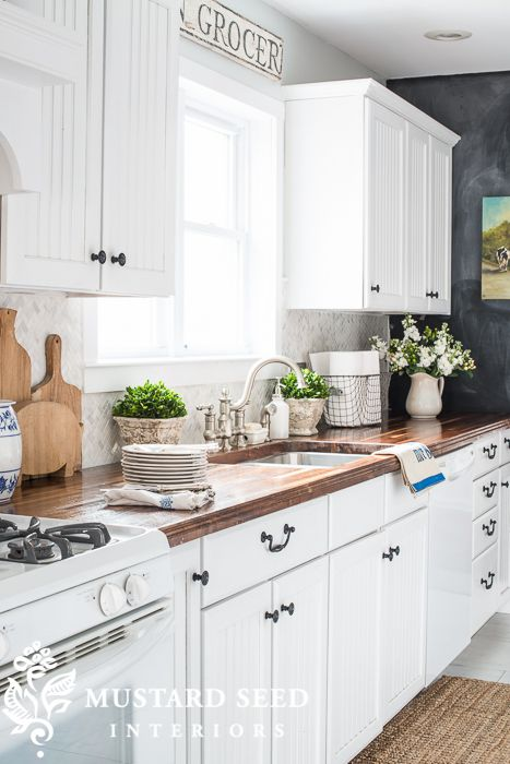 white cabinets with DIY butcher blog counters miss mustard seed