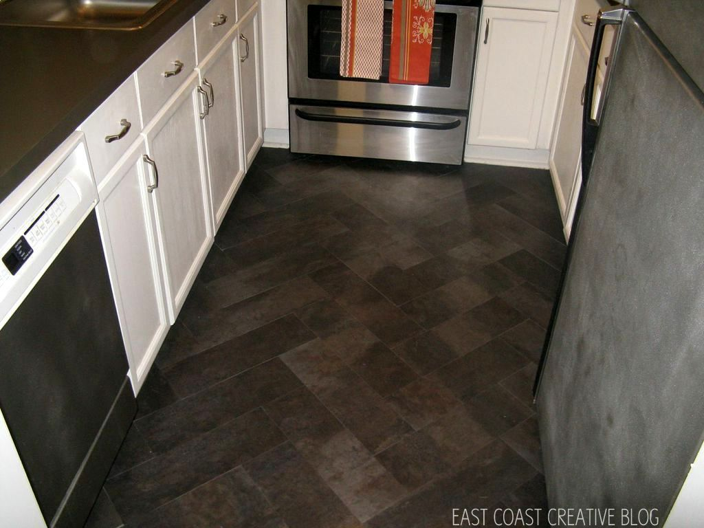 Dark brown wood floor wood kitchen counter along for Kitchen vinyl flooring
