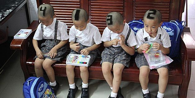 Chinese quadruplets with shaved heads , so parents could tell them apart!