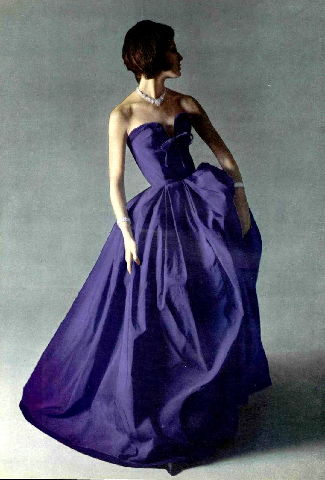Model in gorgeous silk faille gown edged in velvet at the ...