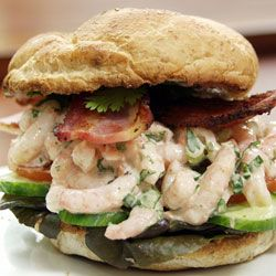 Shrimp salad on a ww kaiser with bacon, tomato, lettuce, cucumber and homemade seafood sauce.