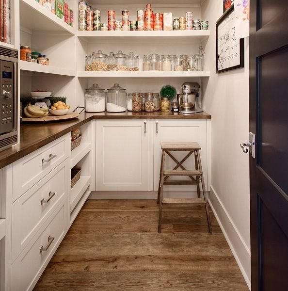 This is actually a really cool idea. Why do we need a large kitchen? This would probably be cheaper to build anyway. We could keep all extra pots/pans, occasional baking equipment and dry food in here. Then have a small kitchen. I think this makes way more sense. #largepantryideas
