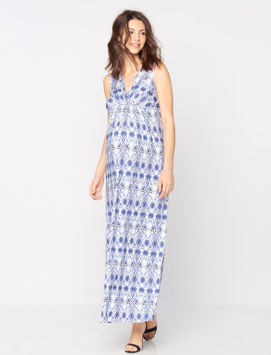 e7175e4cfc0dd Sleeveless ruched maternity maxi dress by Isabella Oliver available at A Pea  in the Pod   Babymoon Packing Essentials