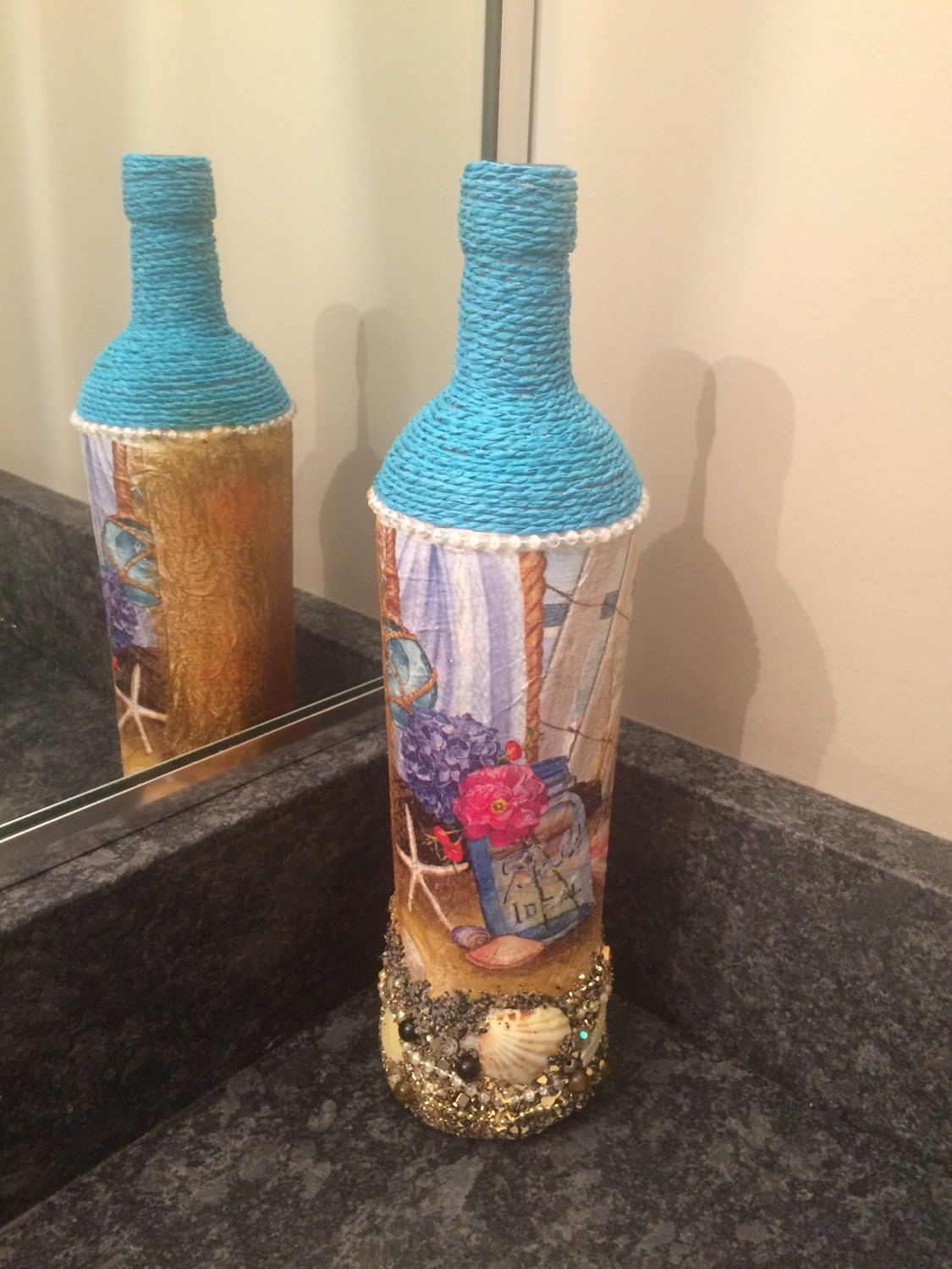 A personal favorite from my Etsy shop https://www.etsy.com/listing/237876359/beach-themed-altered-bottle-altered