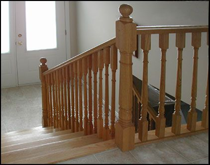 Colonial handrailing and newel posts for interior railings for Interior wood railing designs