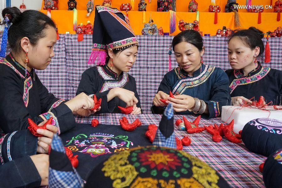Women make traditional sachets to celebrate the upcoming Dragon Boat