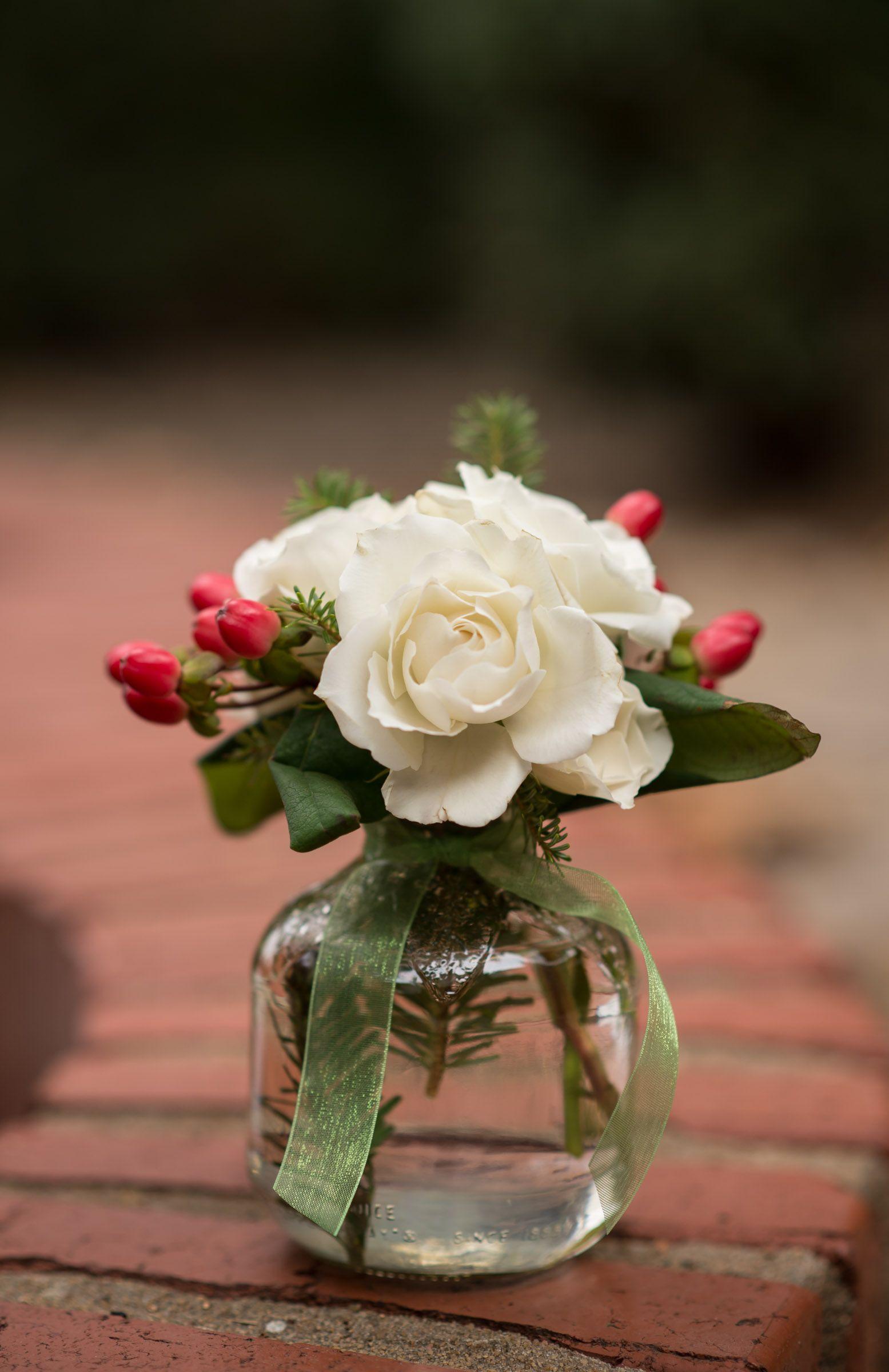floral arrangement using martinelli apple juice bottle cherry hypericum white sweetheart roses christmas