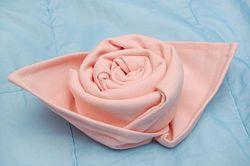 Make a rose out of a cloth napkin
