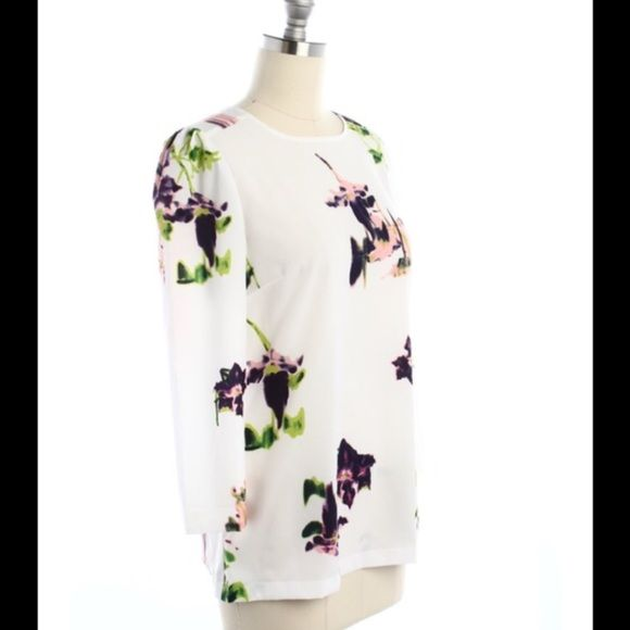 French Connection floral 3/4 sleeve top- 0 & 2 Brand new with $98 tag. Extra button included. I have the following sizes: 0, & 2. This beautiful top is delicate and gorgeous! I love the varied floral design on each top. Truly amazing! Perfect for a work shirt, or a night out with the girls. I have two size 2's, one of the size 2 is missing the loop where the button clasps on the keyhole part on the back of the top. I can discount further for this! It would not be hard to fix. :) the last…
