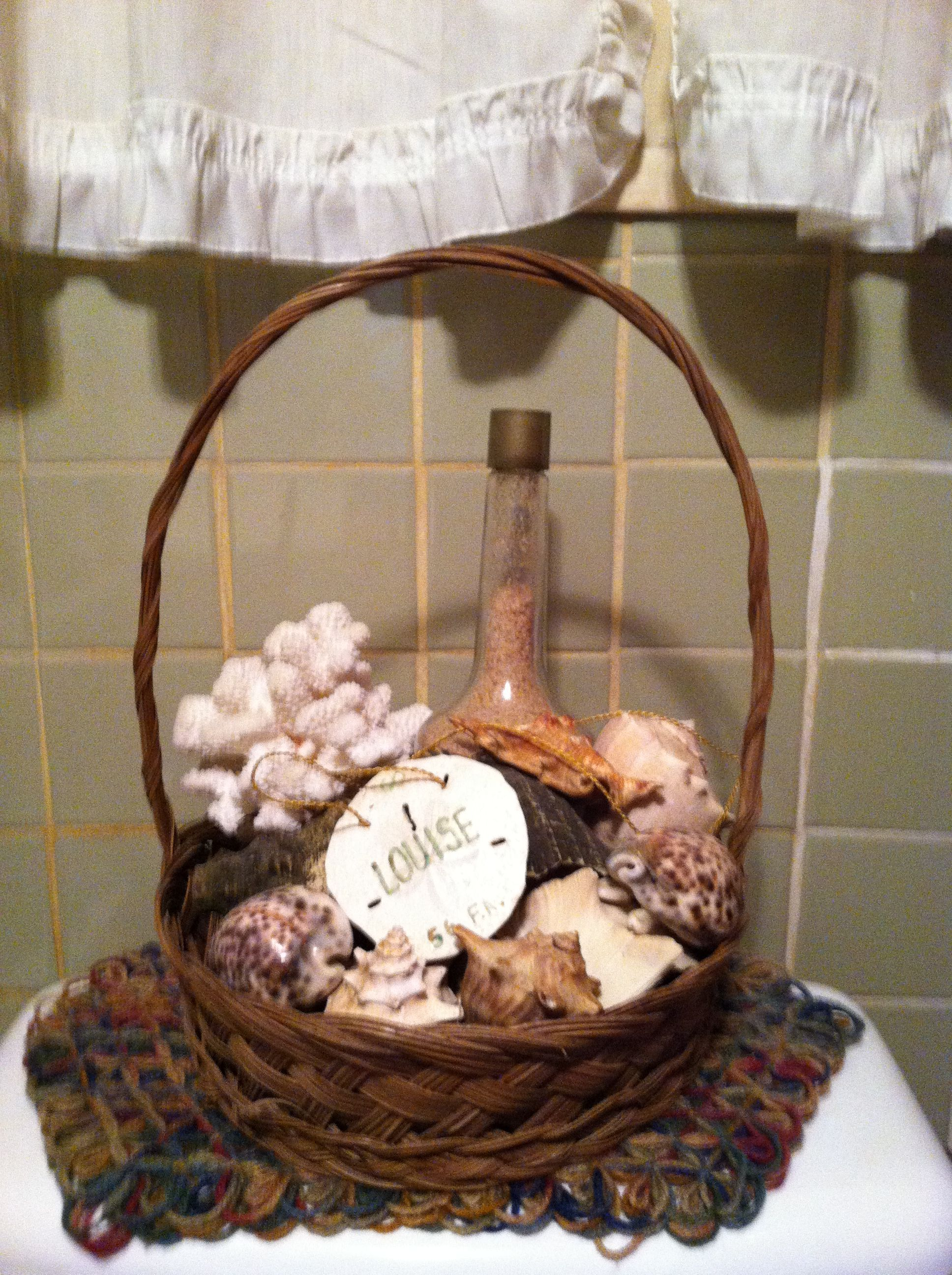 Bathroom basket of sea shells