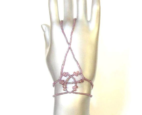 Pink finger bracelet. Strong, comfortable elastic hand chain. Slave bracelet. Hand jewelry. Ring bracelet. Hand flower. Hand piece. Handchain. Fingerbracelet. Slavebracelet. Handjewelry. Ringbracelet. Handbracelet. Handpiece. Handflower. Handjewellery. /// One of a kind! /// Tinna Hand Jewelry, www.handjewellery.com