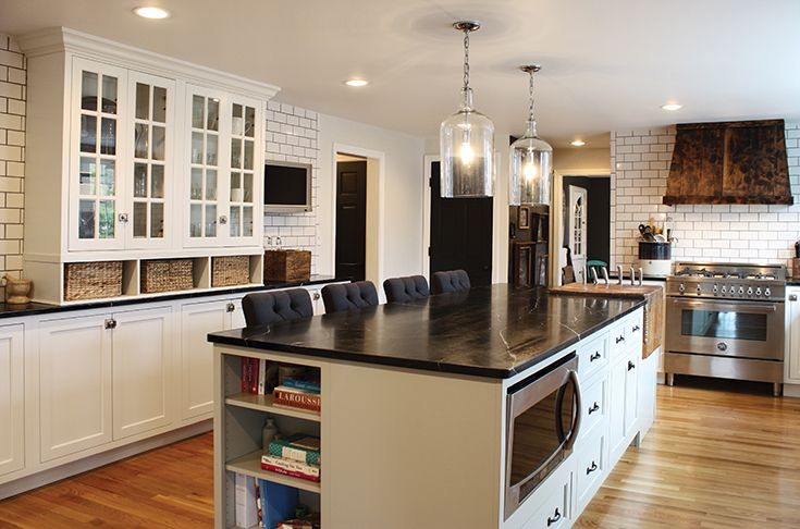 Gorgeous white and gray kitchen with maple inset cabinetry with soapstone countertops.