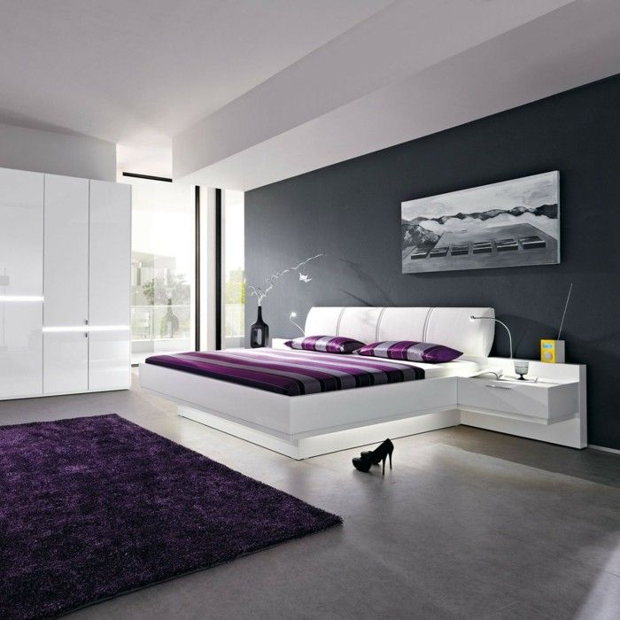White-bedroom-purple-accents-rug-bed-linen-gray-wall
