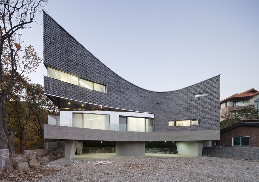 YongIn M House (Curving House) by Joho Architecture.