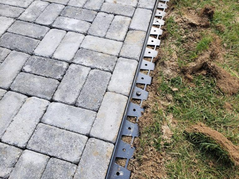 Installing The Paver Edging For Our Diy Concrete Paver Walkway Installation Paver Walkway Diy Paver Walkway Concrete Pavers Walkway
