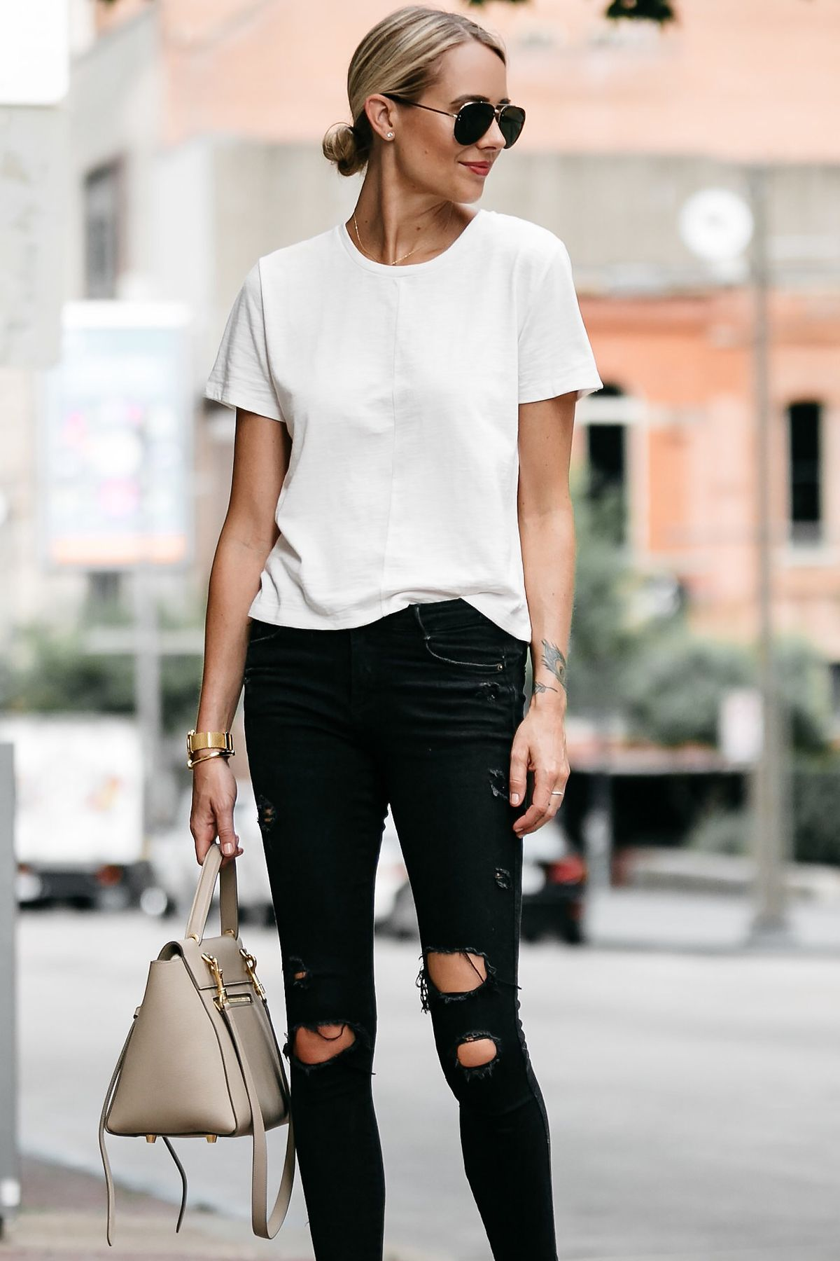 0a4e8ae3 Blonde woman wearing everlane white tshirt zara black ripped skinny jeans  outfit celine belt back street style dallas blogger fashion blogger