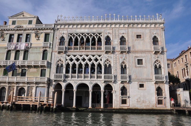How to understand Venice palace architecture, and what features of a Venetian palazzo, from the canal-facing facades to the big chimneys, really mean!