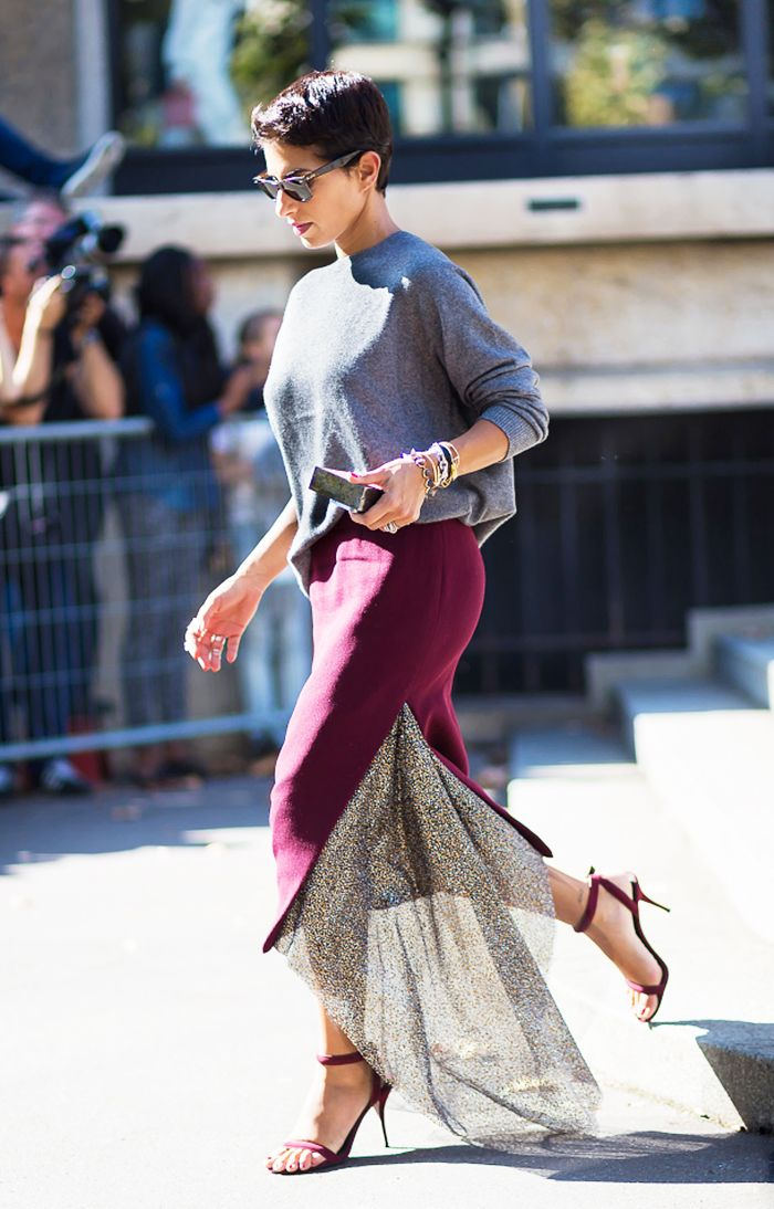 Grey crewneck sweater tucked into a midi skirt with slit and sheer detail