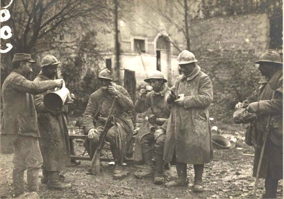 WWI; That first cup of coffee.  Distribution of coffee to the poilus coming back from the frontline in Belleville, Meuse, France - Circa 1917 - Gallica