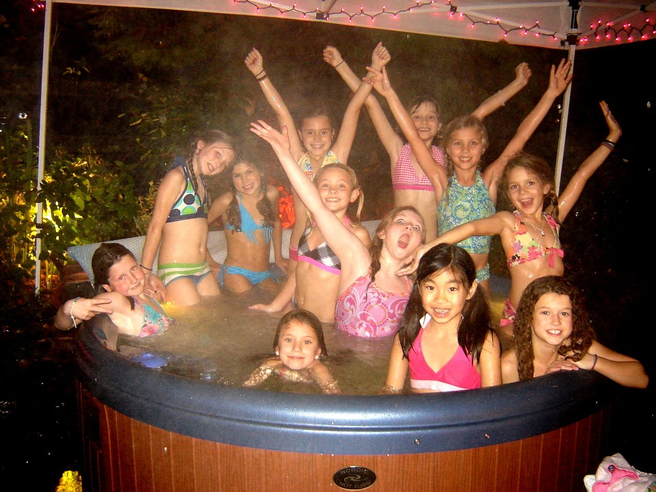 Gotta get wet in the hot tub when you have a birthday party that has ...