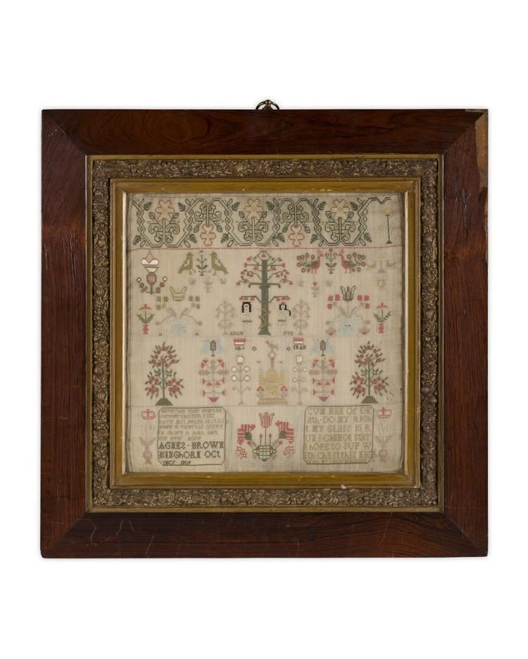 <b>FRAMED NEEDLEWORK SAMPLER, BY AGNES BROWN, KINGHORN, OCTOBER 1809</b> <br /> of square form, worked in polychrome silks depicting a foliate band above the figures of Adam and Eve, bird and flower motifs and two inscriptions, in a gesso and rosewood frame <br /> 33 x 33cm; frame 53 x 53cm