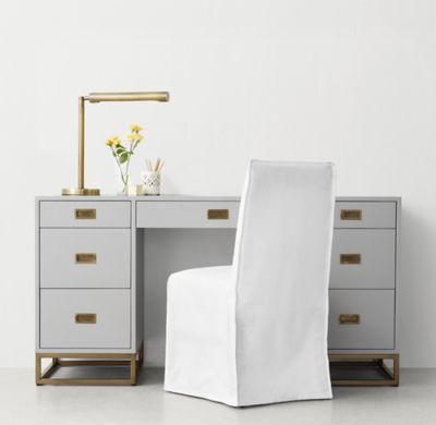 RH TEEN's Avalon Storage Desk:The sleek lines of our collection capture the sophisticated restraint of modernism, while its polished cast-metal fittings