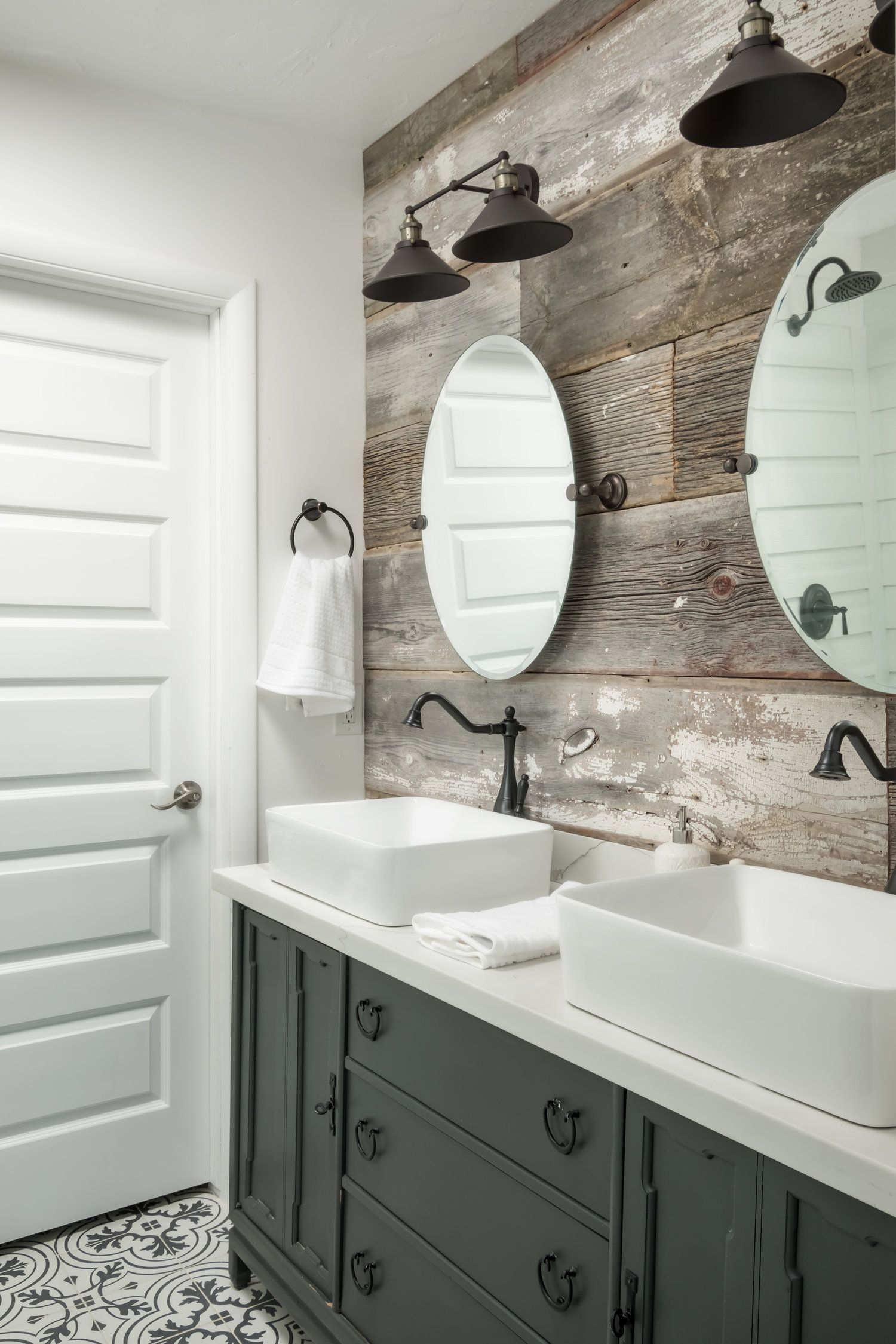 We love how this bathroom features reclaimed wood The dresser