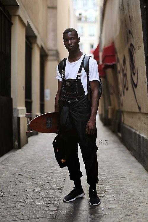 skater lumbersexual balancing contrast of black denim overalls + a white tee, street style + fashion