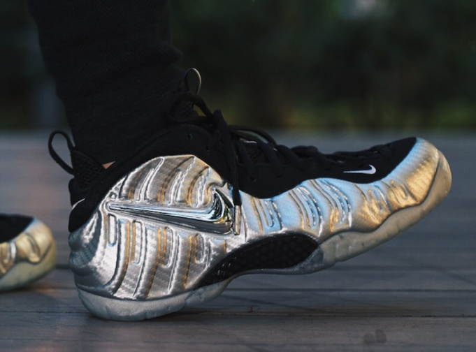 The Nike Air Foamposite Pro Silver Surfer is showcased in a new lifestyle  look. This